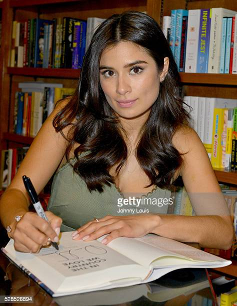 Diane Guerrero signs copies of her book 'In the Country We Love My Family Divided ' at Books and Books on May 5 2016 in Coral Gables Florida