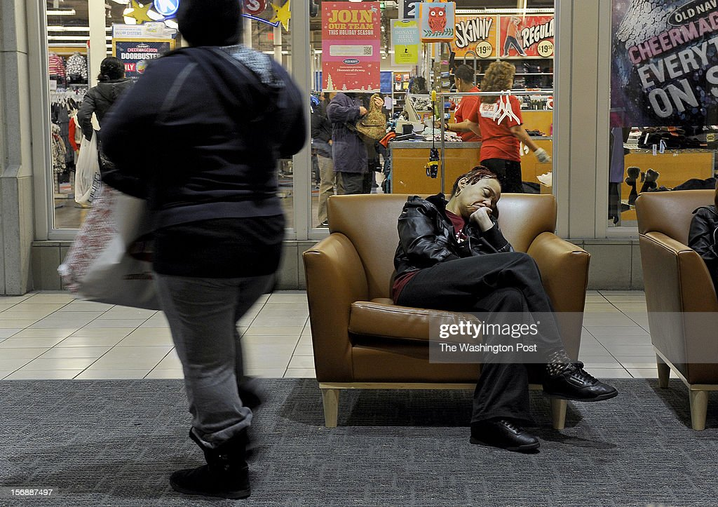 Diane Kemp of the District got to the mall at 3:45am and dozed while waiting for an athletic shoe store to release the style of shoes she wanted to buy for her daughter. Photo was taken at 7am but the shoe release was not scheduled until 8:00am. The J.C. Penney store opened at 6:00 am today in hopes that a Black Friday rush will help sales that have been sluggish of late. (Photo by Michael S. Williamson/The Washington Post via Getty Images