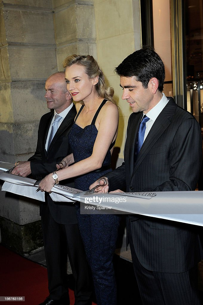 Diane Kruger (C) and CEO Jaeger-LeCoultre Jerome Lambert (R) cut the ribbon to inaugurate the Jaeger-LeCoultre Place Vendome Boutique at Jaeger-LeCoultre Boutique on November 20, 2012 in Paris