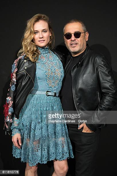Diane Kruger and fashion designer Elie Saab pose backstage prior the Elie Saab show as part of the Paris Fashion Week Womenswear Spring/Summer 2017on...