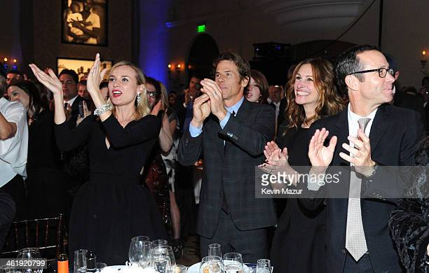 Diane Kruger Danny Moder and Julia Roberts watch U2 perform at the 3rd annual Sean Penn Friends HELP HAITI HOME Gala benefiting J/P HRO presented by...