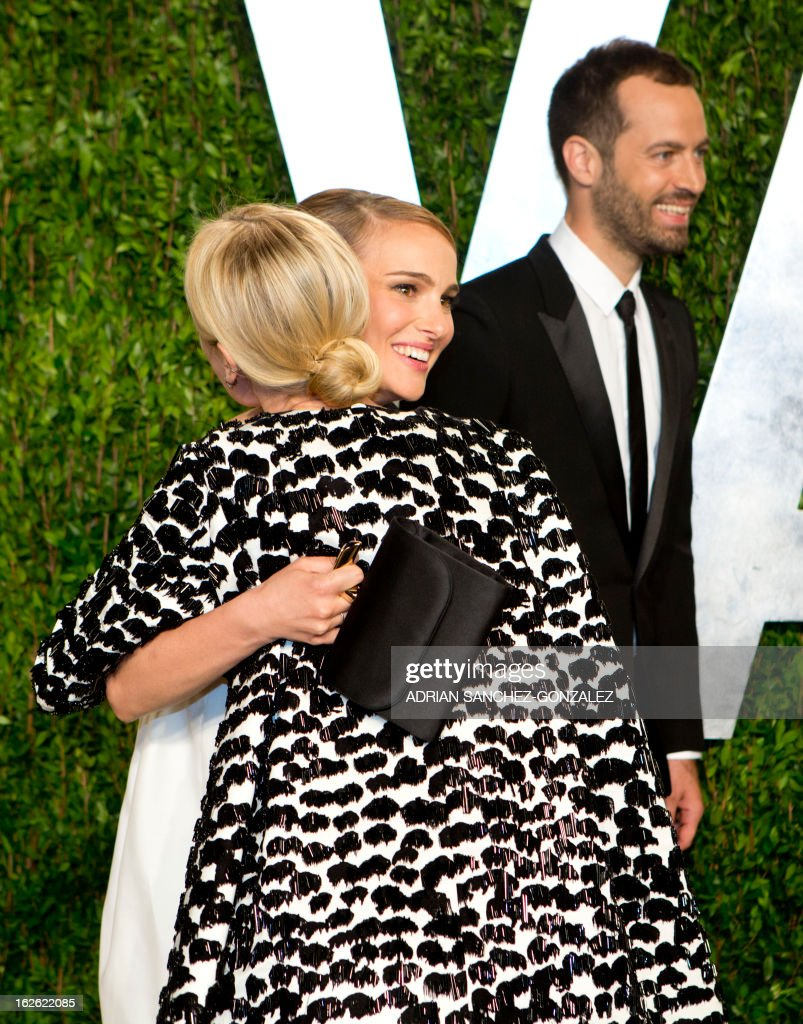 Diane Kruger (C-back to camera) greets Natalie Portman (R-facing) as they arrive for the 2013 Vanity Fair Oscar Party on February 24, 2013 in Hollywood, California following the 85th Academy Awards ceremony.
