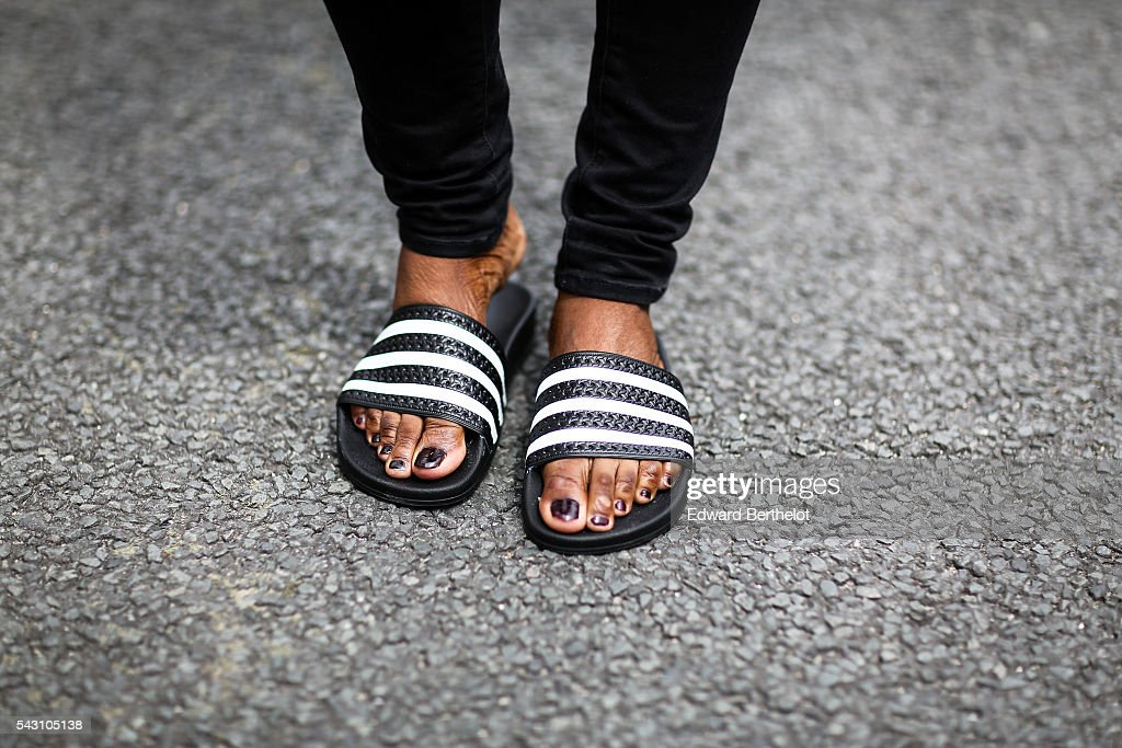 Diane Kuevi is wearing H&M pants, a Misguided top, Adidas shoes, a Pierlot bag and Choies sunglasses, after the Avoc show, during Paris Fashion Week Menswear Spring/summer 2017, on June 25, 2016 in Paris, France.