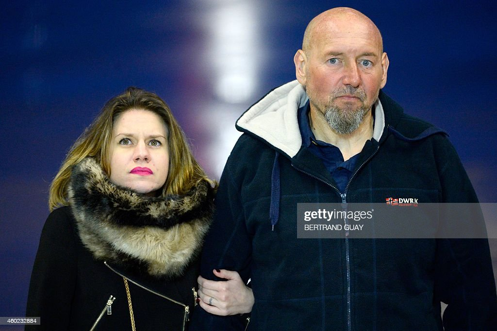 Diane Lazarevic and her father <a gi-track='captionPersonalityLinkClicked' href=/galleries/search?phrase=Serge+Lazarevic&family=editorial&specificpeople=9859570 ng-click='$event.stopPropagation()'>Serge Lazarevic</a>, France's last remaining hostage, look on as the French President addresses the media after Lazarevic and his daughter landed in a French Republic plane at the Villacoublay military base near Paris on December 10, 2014. Lazarevic, who was snatched by armed men in Mali on November 24, 2011, arrived home on December 10 after three years at the hands of Islamist militants, and was greeted by French President Francois Hollande.