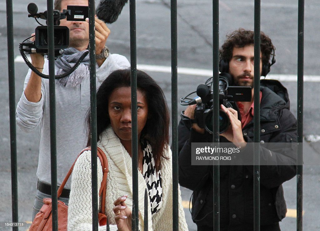Diane Mistler, a Madagascan woman who allegedly tricked one of her many lovers into killing her husband with a fishing harpoon arrives at Perpignan's courthouse, on October 18, 2012, prior to the opening hearing of her appeal trial. Mistler is appealing against a 25-year prison sentence when she was found guilty in a first trial in this case in April 2011. AFP PHOTO / RAYMOND