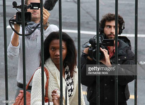 Diane Mistler a Madagascan woman who allegedly tricked one of her many lovers into killing her husband with a fishing harpoon arrives at Perpignan's...