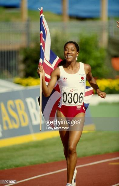 Diane Modahl of Great Britain celebrates after winning the gold medal in the Womens 800 metres event during the Commonwealth Games in Auckland New...