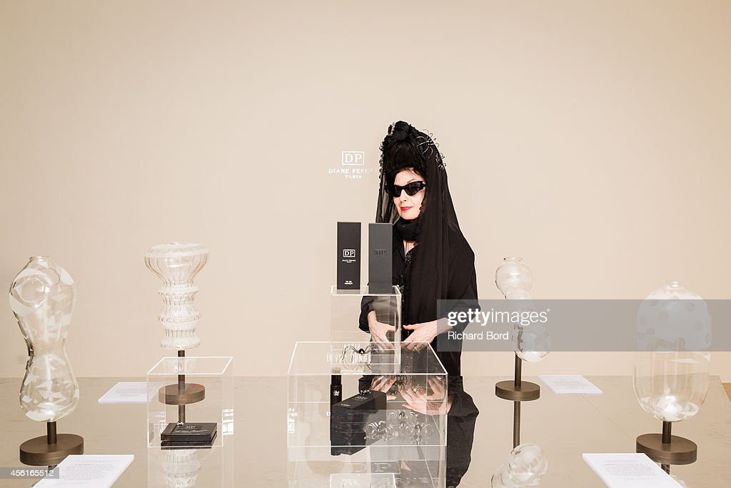 <a gi-track='captionPersonalityLinkClicked' href=/galleries/search?phrase=Diane+Pernet&family=editorial&specificpeople=4347865 ng-click='$event.stopPropagation()'>Diane Pernet</a> attends the 'First Fragance Collection By <a gi-track='captionPersonalityLinkClicked' href=/galleries/search?phrase=Diane+Pernet&family=editorial&specificpeople=4347865 ng-click='$event.stopPropagation()'>Diane Pernet</a>' : Launch Party as part of the Paris Fashion Week Womenswear Spring/Summer 2015 on September 26, 2014 in Paris at Galerie de Valois, France.