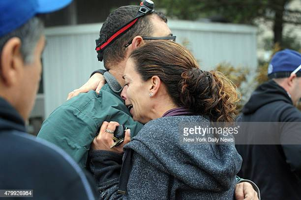 Diane Perrotta hugs her husband John after a scare that he was trapped by debris in the aftermath of Hurricane Sandy he was found okay Breezy Point...