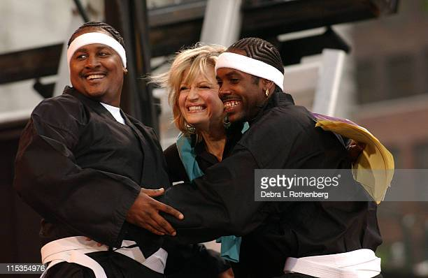 Diane Sawyer and members of Outkast during The 'Good Morning America' 2004 Summer Concert Series Outkast at Bryant Park in New York City New York...