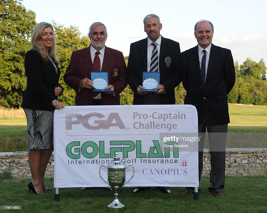 Diane Simmons of Golfplan with Michael Izzard (A), Rob Edwards of Lee-on-the-Solent golf club and Roger Harvey of Golfplan celebrate their victory after the Golfplan Challenge Regional Qualifier at Golf at Goodwood on August 27, 2013 in Chichester, England.