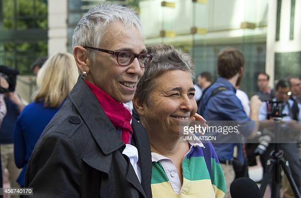 Diane Ullius and Rhonda Buckner who got a samesex marriage in Toronto Canada talk with reporters after Virginia Attorney General Mark R Herring...