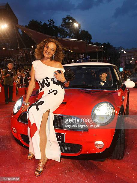 APPLY Diane von Fuerstenberg poses on a Mini car during the 18th Life Ball at Town Hall on July 17 2010 in Vienna Austria The Life Ball is an annual...