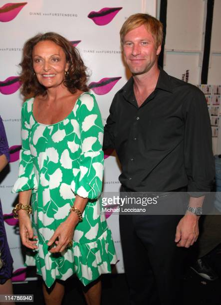 Diane Von Furstenberg and Aaron Eckhart during Olympus Fashion Week Spring 2007 Diane Von Furstenberg Front Row and Backstage at The Tent Bryant Park...