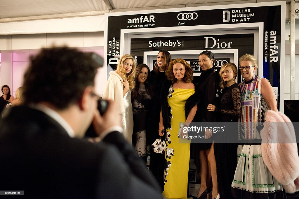 Diane Von Furstenberg (C) and guests arrive for the 2013 TWO x TWO for AIDS and Art Gala at the Rachofsky House on October 26, 2013 in Dallas, Texas.