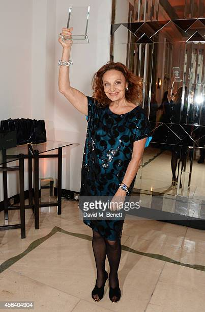 Diane von Furstenberg winner of the Fashion Icon award poses at the Harper's Bazaar Women Of The Year awards 2014 at Claridge's Hotel on November 4...