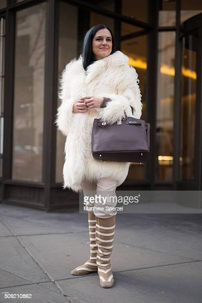 Diane Vukas is seen on Rush Street wearing a cream white ÔFur Free FurÕ Stella McCartney coat chocolate leather Hermes bag bone Brunello Cucinelli...