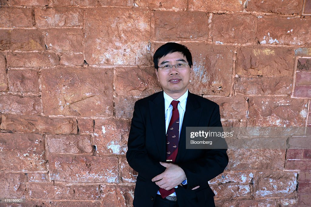 Dianmin Chen, chief executive officer of Norton Gold Fields Ltd., poses for a photograph at the company's Paddington operations 35 kilometers north-west of Kalgoorlie, Australia, on Wednesday, Aug. 7, 2013. Norton, the Australian producer controlled by China's Zijin Mining Group Co., is seeking further acquisition targets as falling prices cut the value of mines. Photographer: Carla Gottgens/Bloomberg via Getty Images
