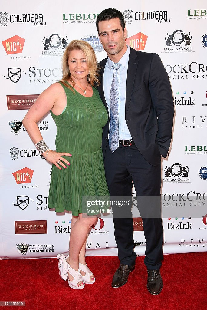 Dianne Burnett and actor/model Dustin Moss arrive at the 40th Anniversary StockCross Party on July 25, 2013 in Beverly Hills, California.