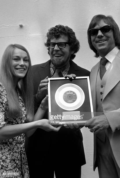 Dianne Lee and Lennie Peters with Rolf Harris with a gold disc presented to them for 500000 plus sales of their first charttopping single 'Welcome...