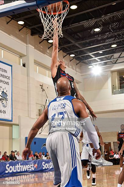 Diante Garrett of the Los Angeles Clippers goes for the layup against Sundiata Gaines of the Detroit Pistons during the game on July 5 2015 at Amway...