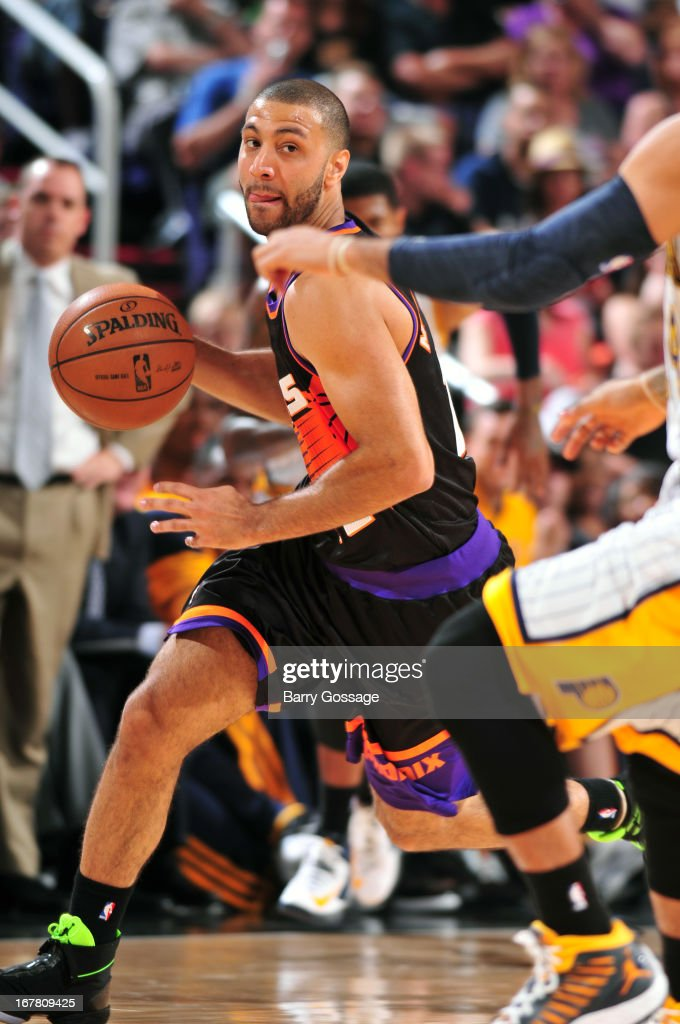<a gi-track='captionPersonalityLinkClicked' href=/galleries/search?phrase=Diante+Garrett&family=editorial&specificpeople=4846709 ng-click='$event.stopPropagation()'>Diante Garrett</a> #10 of the Phoenix Suns brings the ball up court against the Indiana Pacers on March 30, 2013 at U.S. Airways Center in Phoenix, Arizona.