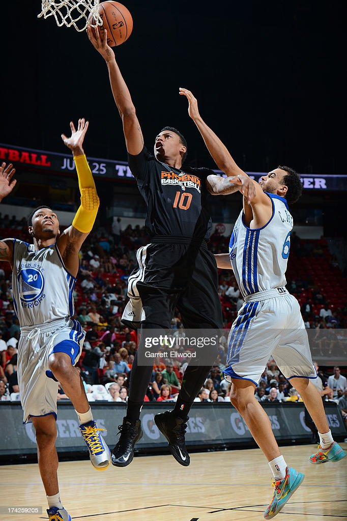 <a gi-track='captionPersonalityLinkClicked' href=/galleries/search?phrase=Diante+Garrett&family=editorial&specificpeople=4846709 ng-click='$event.stopPropagation()'>Diante Garrett</a> #10 of the Phoenix Suns drives to the basket against the Golden State Warriors during NBA Summer League Championship Game on July 22, 2013 at the Cox Pavilion in Las Vegas, Nevada.
