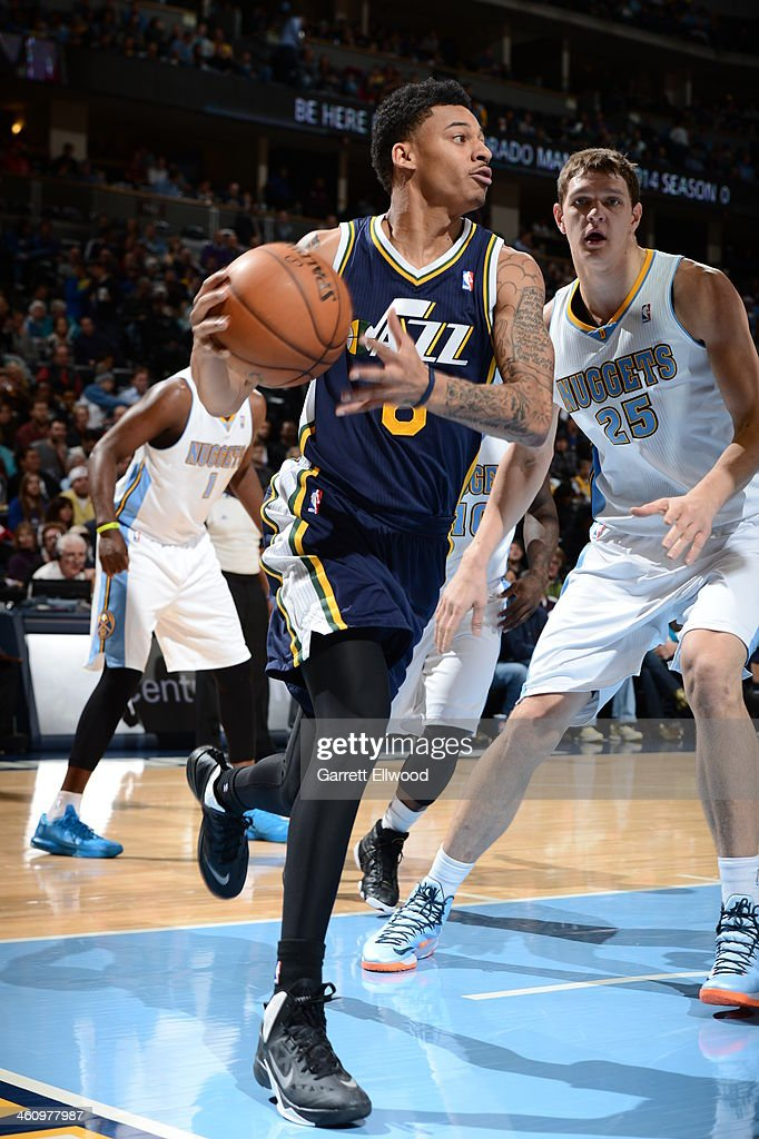 <a gi-track='captionPersonalityLinkClicked' href=/galleries/search?phrase=Diante+Garrett&family=editorial&specificpeople=4846709 ng-click='$event.stopPropagation()'>Diante Garrett</a> #8 of the Utah Jazz drives to the basket against the Denver Nuggets on December 13, 2013 at the Pepsi Center in Denver, Colorado.