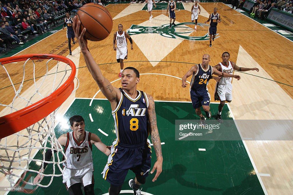 Diante Garrett #8 of the Utah Jazz shoots against Ersan Ilyasova #7 of the Milwaukee Bucks on March 3, 2014 at the BMO Harris Bradley Center in Milwaukee, Wisconsin.