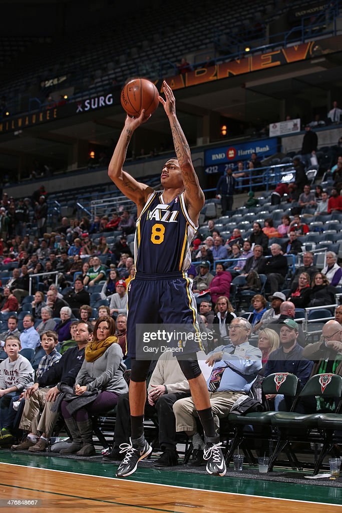 <a gi-track='captionPersonalityLinkClicked' href=/galleries/search?phrase=Diante+Garrett&family=editorial&specificpeople=4846709 ng-click='$event.stopPropagation()'>Diante Garrett</a> #8 of the Utah Jazz shoots against the Milwaukee Bucks on March 3, 2014 at the BMO Harris Bradley Center in Milwaukee, Wisconsin.