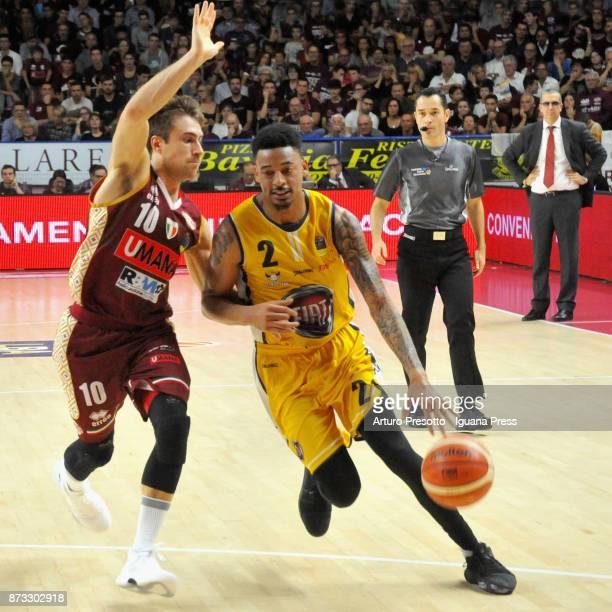 Diante Maurice Garrett of Fiat competes with Andrea De Nicolao of Umana during the LBA LegaBasket of Serie A match between Reyer Umana Venezia and...