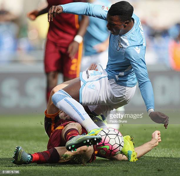 Diao Balde Keita of SS Lazio is fauled by Kostas Manolas of AS Roma during the Serie A match between SS Lazio and AS Roma at Stadio Olimpico on April...