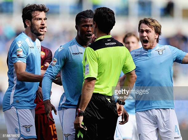 Diao Balde Keita with his teammates of SS Lazio protest with the referee Luca Banti during the Serie A match between SS Lazio and AS Roma at Stadio...