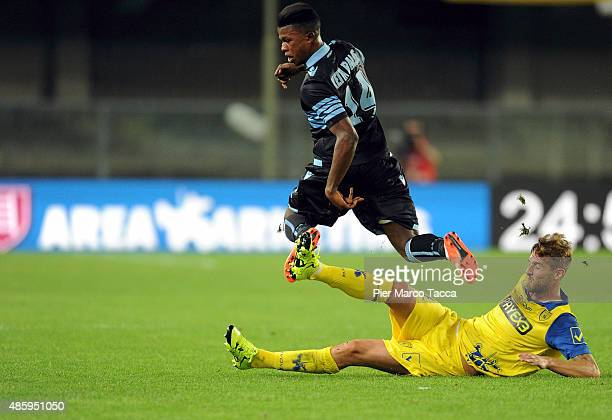 Diao Blade Keita of SS Lazio competes for the ball with Nicola Rigoni of AC Chievo during the Serie A match between AC Chievo Verona and SS Lazio at...