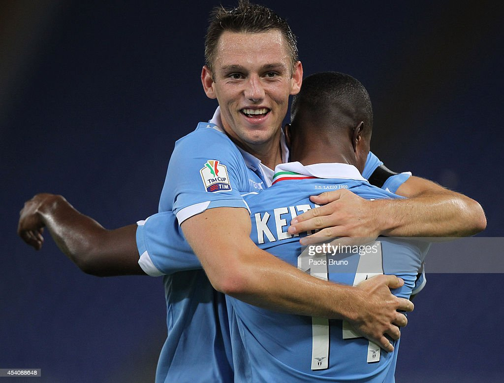 Diao Keita Balde with his teammate <a gi-track='captionPersonalityLinkClicked' href=/galleries/search?phrase=Stefan+De+Vrij&family=editorial&specificpeople=5842709 ng-click='$event.stopPropagation()'>Stefan De Vrij</a> (L) of SS Lazio celebrates after scoring the second team's goal during the TIM Cup match between SS Lazio and Bassano FC at Olimpico Stadium on August 24, 2014 in Rome, Italy.