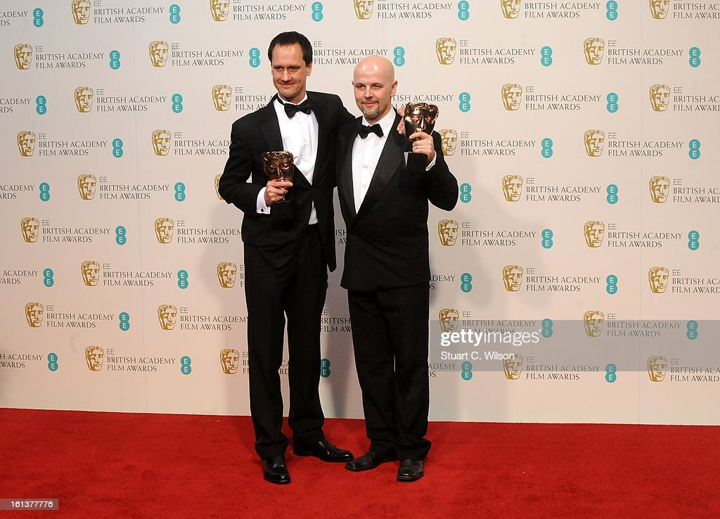 Diarmid Scrimshaw and Peter Carlton, winners of the Short Film award for 'Swimmer', pose in the press room at the EE British Academy Film Awards at The Royal Opera House on February 10, 2013 in London, England.