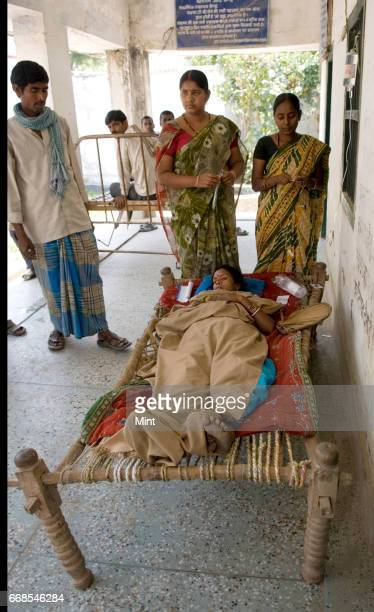 diarrhea patient indermati devi [35yrs] with husband naresh das who brought her to the raghopur Primary Health Care center in a cot on April 8 2010...