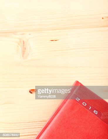 Diary 2016 on light wooden table : Stockfoto