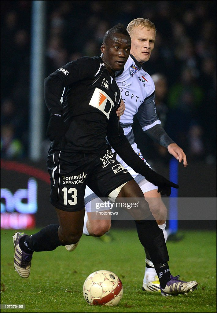 N'Diaye Mamoutou of Gent and Karel Geraerts of Leuven in action during the Jupiler League match between Oud Herverlee Leuven OHL and KAA Gent on December 1, 2012 in Oud-Herverlee, Belgium.