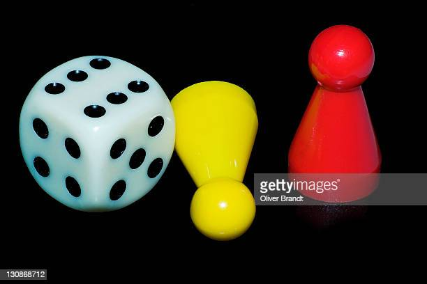 Dice and pawn in a game