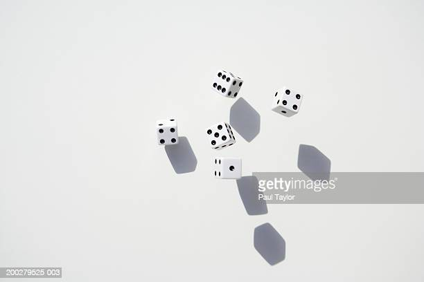 Dice casting shadows on grey surface