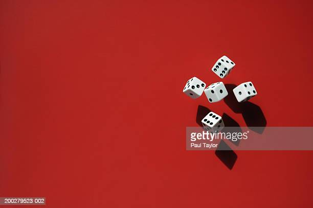 Dice casting shadows on red background
