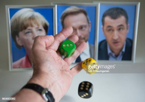 Dice game around a new federal government Symbol photo on the topic of coalition negotiations Jamaica coalition The photo shows framed pictures of...