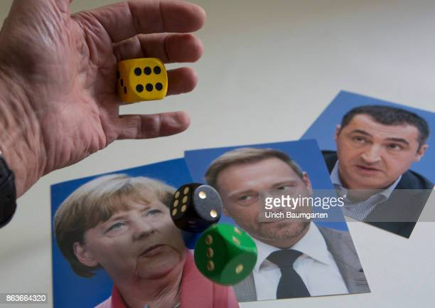 Dice game around a new federal government Symbol photo on the topic of coalition negotiations Jamaica coalition The photo shows portrait photos of...