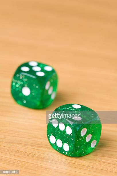 Dice on a table, two and five