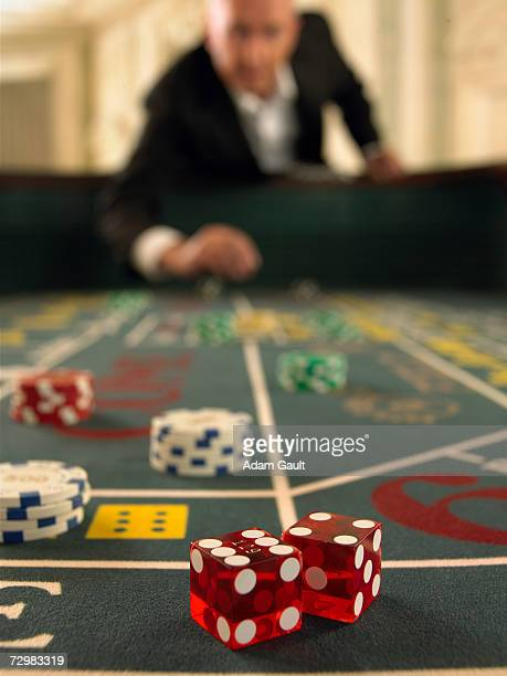 Dice on craps table in casino