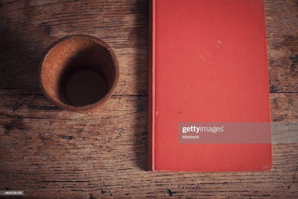 Dice shaker and book : Stock Photo