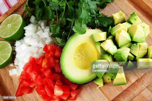 Diced avocado, tomato, and onion on chopping board