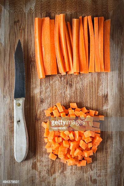 Diced carrots and knife on chopping board