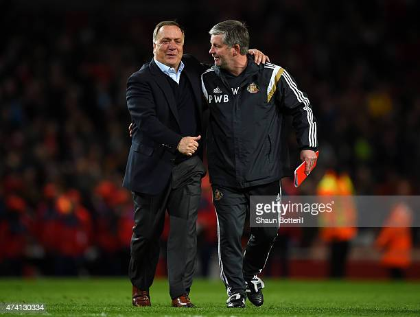 Dick Advocaat Manager of Sunderland celebrates with a member of coaching staff as his team avoid relegation during the Barclays Premier League match...